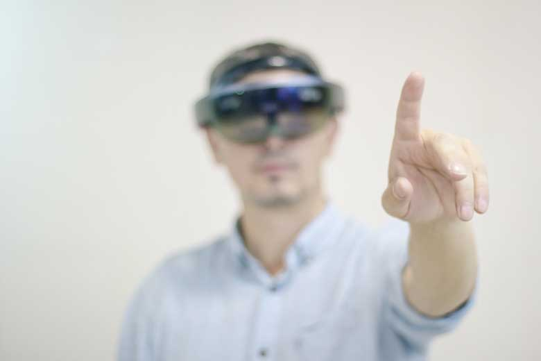 American businessman with Augmented Reality goggles from MS.