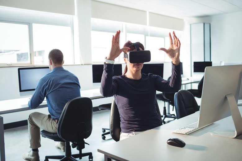 SPECTRUM Trainee using VR Googles at work.
