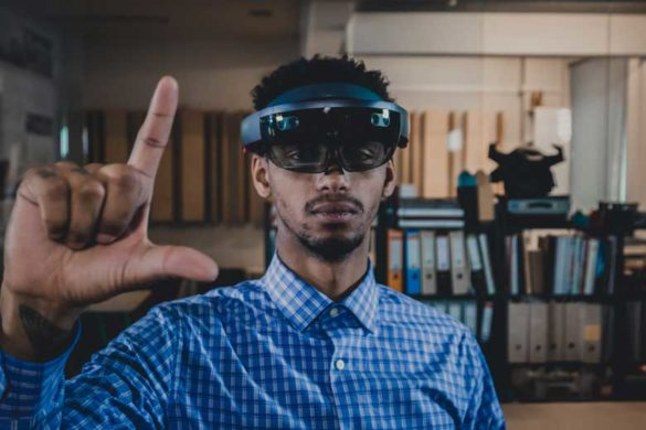 African american SPECTRUM Trainee uses a Augmented Reality Hololens.