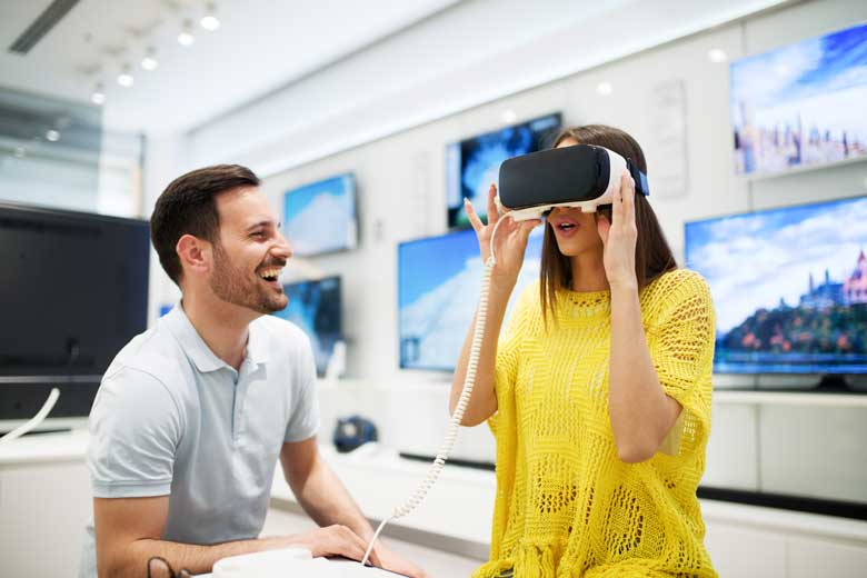 Couple using VR Goggles in a Tech Store.